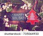 happy holiday written on wooden ... | Shutterstock . vector #735064933