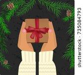 hands holding christmas gift... | Shutterstock .eps vector #735084793