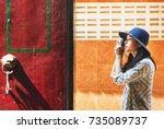 the solo asian female traveler | Shutterstock . vector #735089737