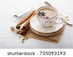 warm chai tea with milk and... | Shutterstock . vector #735093193
