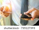 business man entering data of a ... | Shutterstock . vector #735127393