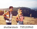 young man and woman backpackers ... | Shutterstock . vector #735133963