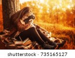 girl and a cat in the autumn... | Shutterstock . vector #735165127