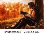 girl and a cat in the autumn... | Shutterstock . vector #735165133