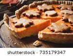 pumpkin pie with slice cut out. ... | Shutterstock . vector #735179347