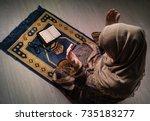 muslim woman praying for allah... | Shutterstock . vector #735183277