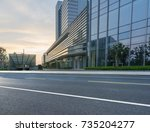 empty road with modern... | Shutterstock . vector #735204277