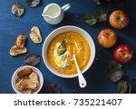 baked apples and pumpkin soup...   Shutterstock . vector #735221407