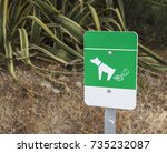 A Green Background Sign With A...
