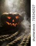 Small photo of Halloween pumpkin head. Scary evil face spooky holiday. Helloween part. Helloween attributes.