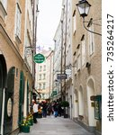 Small photo of SALZBURG, AUSTRIA: 12 September 2017: Tourists walk in Goldgasse, is a narrow passageway leading from an arcade on Residence Square to Old Marketplace.