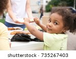 volunteer sharing food with... | Shutterstock . vector #735267403