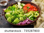 vegan salad of fresh vegetables ... | Shutterstock . vector #735287803