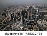 panorama sunset view to dubai... | Shutterstock . vector #735312433
