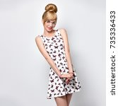Fashion Young Blond Woman In...