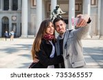 couple of tourists  a man and a ... | Shutterstock . vector #735365557