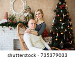 christmas couple.happy smiling... | Shutterstock . vector #735379033