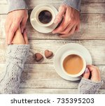 a man and a woman holding cups...   Shutterstock . vector #735395203