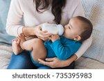 little infant baby lying on... | Shutterstock . vector #735395983