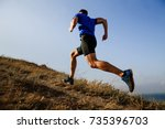 dynamic running uphill on trail ... | Shutterstock . vector #735396703