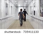 Small photo of People are walking towards the plane, Aviation bridge, Airplane , a man ,Jet way