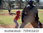 young baseball player at the...   Shutterstock . vector #735411613