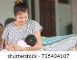 beautiful happy mother... | Shutterstock . vector #735434107