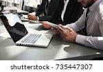 business people meeting... | Shutterstock . vector #735447307