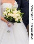 bouquet in the hands of bride. | Shutterstock . vector #735505027