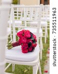 wedding bouquet on white chair. | Shutterstock . vector #735511963