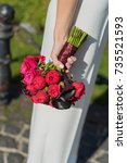 bouquet in the hands of bride. | Shutterstock . vector #735521593