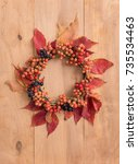 thanksgiving wreath over wooden ... | Shutterstock . vector #735534463