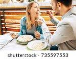 young couple enjoying... | Shutterstock . vector #735597553