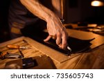 working process of the leather... | Shutterstock . vector #735605743