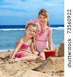 little girl  playing on  beach. | Shutterstock . vector #73560922