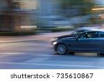car moving across the street.... | Shutterstock . vector #735610867