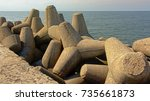 Small photo of Concrete tetrapod armour units aside Liepaja Northern breakwater in the old soviet military base of KArosta