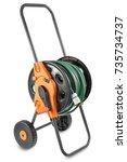watering garden hose on the... | Shutterstock . vector #735734737
