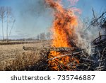 flames and smoke from burning a ... | Shutterstock . vector #735746887