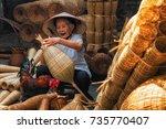old vietnamese female craftsman ... | Shutterstock . vector #735770407