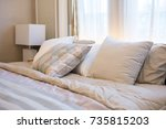 set of clean pillows on luxury... | Shutterstock . vector #735815203
