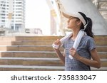 asian woman jogging at the park.... | Shutterstock . vector #735833047