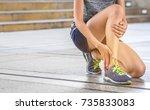 ankle twist sprain accident in...   Shutterstock . vector #735833083