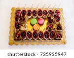 dessert table for a party.... | Shutterstock . vector #735935947