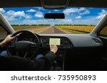 man hand using gps navigation... | Shutterstock . vector #735950893