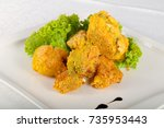 fried broccoli with salad leaves | Shutterstock . vector #735953443