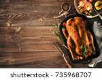 roast christmas duck with thyme ... | Shutterstock . vector #735968707