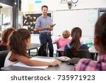 teacher with tablet in front of ... | Shutterstock . vector #735971923