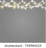 christmas lights isolated on...   Shutterstock .eps vector #735984223