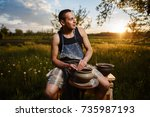 young man potter making ceramic ... | Shutterstock . vector #735987193